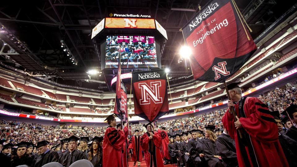 The procession of gonfalons winds its way onto the Pinnacle Bank Arena floor during UNL's December 2013 undergraduate commencement ceremony.
