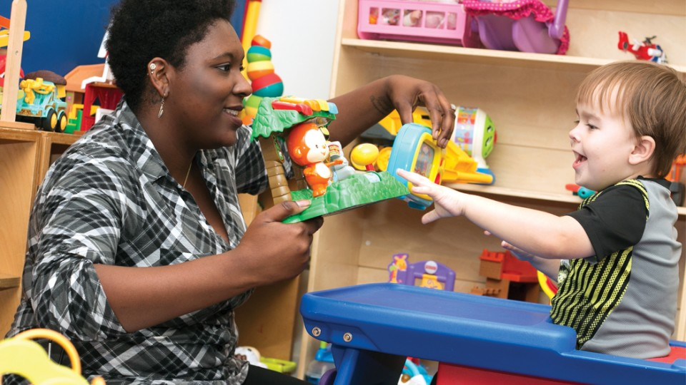 Micheale Marcus works with a child as part of the university's early childhood autism spectrum disorder training program.