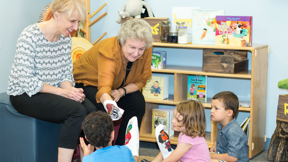 From right, Gwen Nugent, CYFS research professor, and Kathleen Rudasill, professor of educational psychology and associate dean for research and faculty development at Virginia Commonwealth University, introduce children to a few of the puppet characters