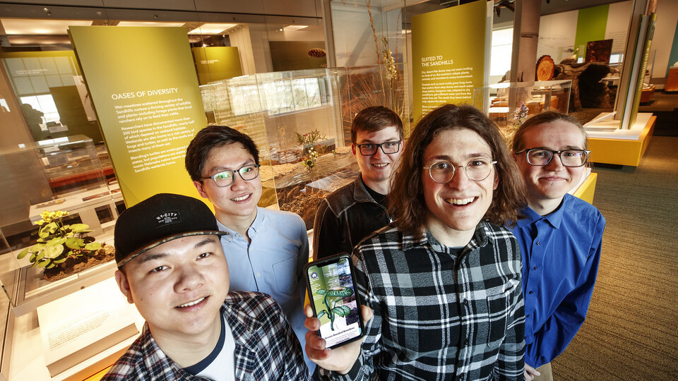 A team of students from computer science and engineering built a virtual reality app to enhance the information at the Nebraska State Museum's new Cherish Nebraska exhibit. The team is comprised of (from left) Ziyuan Ye, JunShen Ban, Brandon Heuttner, Mat