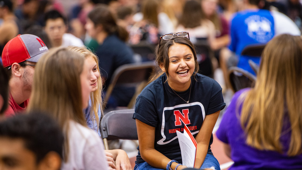 Students talk during the Husker Dialogues at the start of the fall semester.