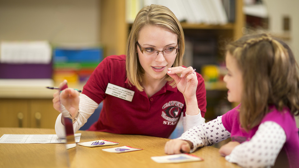 A master's student works one-on-one with a child through a Department of Special Education and Communication Disorders program. The department recently received a $1 million grant to train at least 30 master's level students to assist youth who are deaf or hard of hearing.