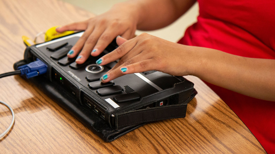 Using a Braille writing machine, a student writes a paper at the Nebraska Center for the Education of Children who are Blind or Visually Impaired in Nebraska City.