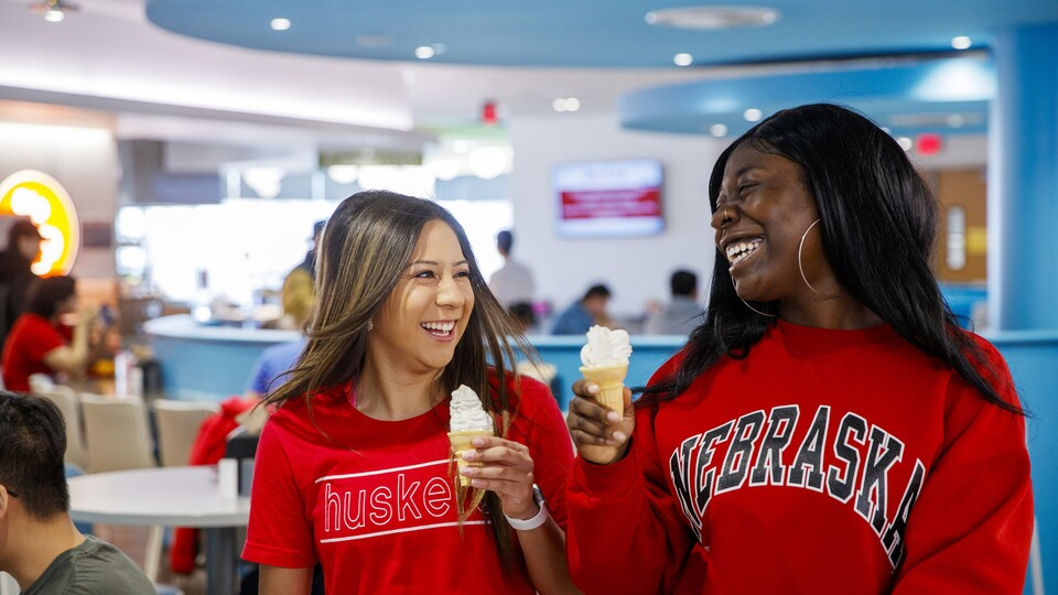Students enjoy an ice cream cone at Cather Dining Center.