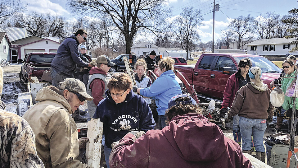 Nebraska Extension and community volunteers combine flood relief efforts in spring 2019, after floods ravaged much of the state. (Photo by Jason Wessendorf, Verdigre Eagle)