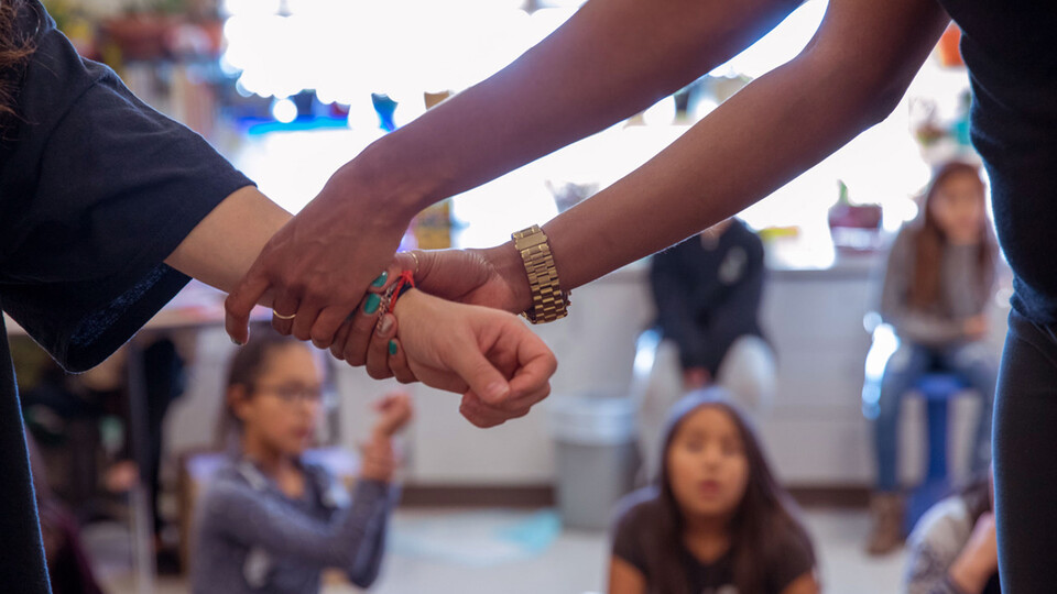 Instructors work with children on a Native American reservation as part of the IMpower violence prevention program. (Photo courtesy of Brooke Duthie Photography)