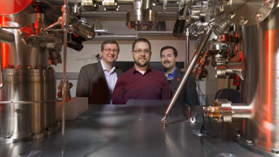 UNL physicists (from left) Evgeny Tsymbal, John D. Burton and Alexei Gruverman in the UNL Materials Research Science and Education Center's Thin Film Growth and Characterization Facility. (Photo by Craig Chandler/University Communications)