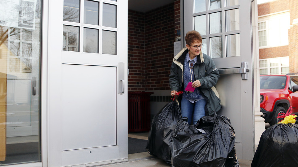 Linda Kern, of Clinton Elementary School, helps bring in the donations from the SNR Caring for Clinton Drive on Tuesday, Dec. 11, at the school on 29th and Holdrege streets.