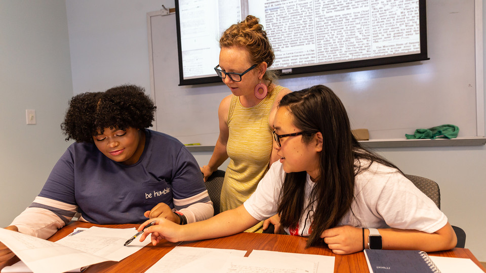 Katrina Jagodinsky, associate professor of history, advises two undergraduate researchers on a research project in the Center for Digital Research in the Humanities.