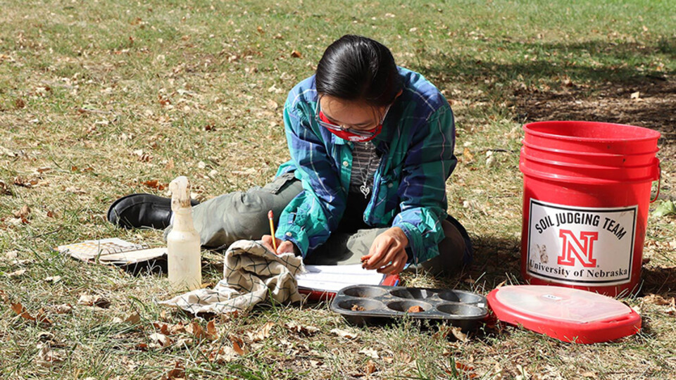 Phuong Minh Tu Le makes notes about her soil texture and soil color determinations during an Oct. 2 practice session in advance of the Region 5 Soil Judging Competition. The competition is being held virtually this year. Lana Koepke Johnson | Department o