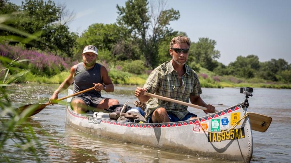 "Mike Forsberg and Pete Stegen canoe down the Platte River during filming of the ""Follow the Water"" documentary."