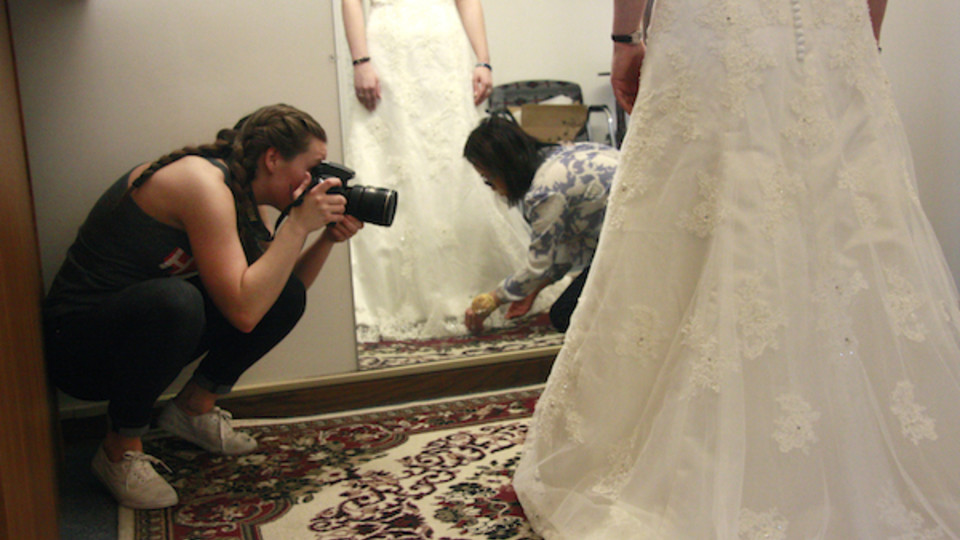 Alanna Johnson photographs May Nguyen as she works on a customer's wedding dress in her shop, May's Alterations. The photos were for the Nebraska Mosaic project.