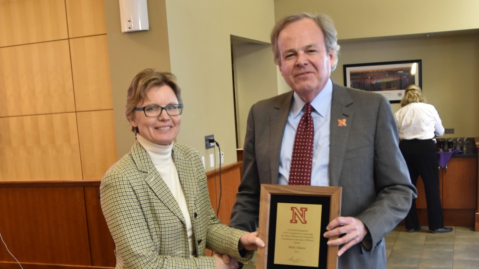 Mark Askren (right) poses with Susan Foster, director of institutional equity and compliance, after the presentation of the Outstanding Contribution to the Status of Women Award on March 17.
