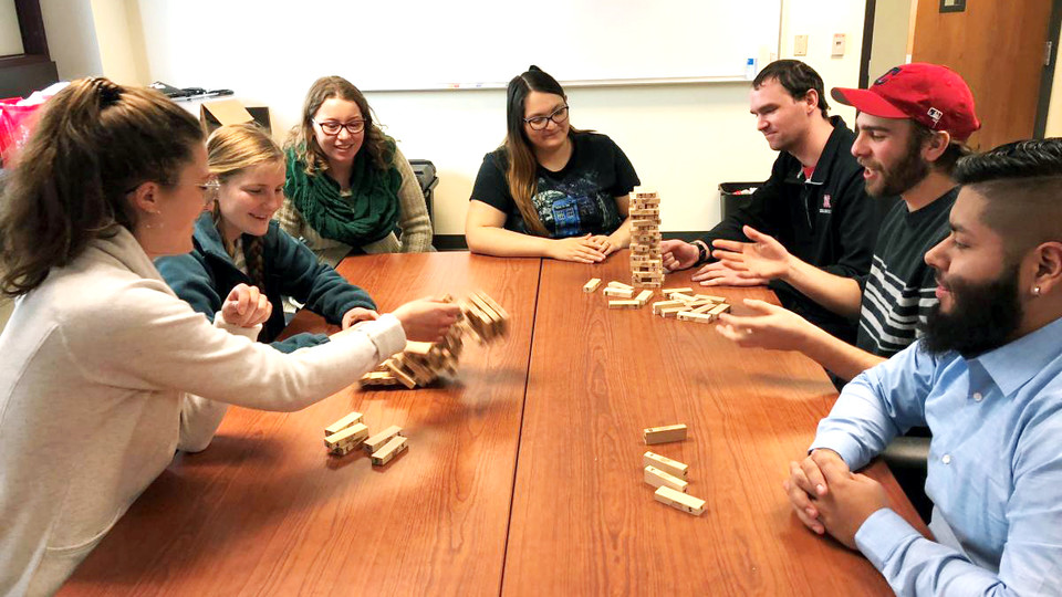 CRE students number the blocks in the game Jenga and play it with special rules to teach resilience concepts. Pictured are, from left, Julie Fowler, Jessica Johnson, Alison Ludwig, Rubi Quiñones, Conor Barnes, Dominic Cristiano and Daniel Morales.