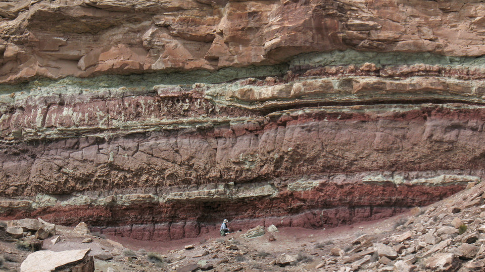 Matt Joeckel, Conservation and Survey Division director, is seen mapping the Yellow Cat Formation of the Cedar Mountain Formation in Utah. | Photo courtesy Jim Kirkland, Utah Geological Survey