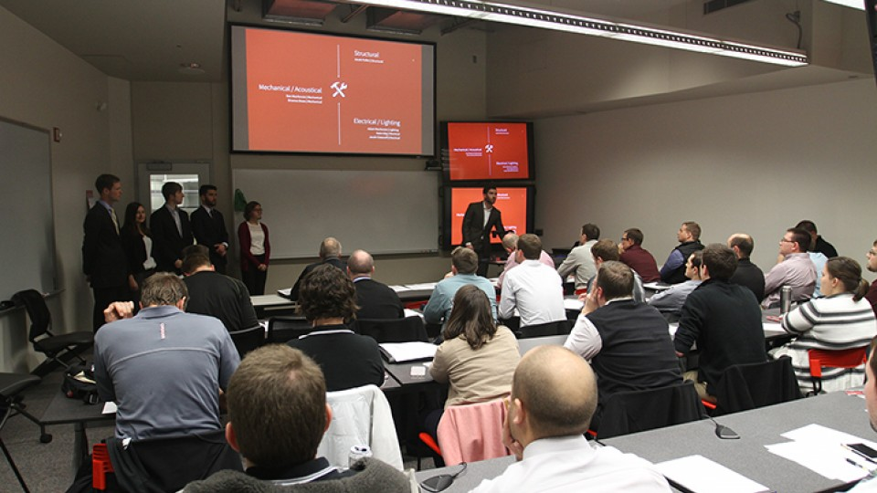 Members of the Durham School team present their project to mentors and evaluators as part of the Architectural Engineering 8030-8040 Interdisciplinary Team Design Project classes in the senior capstone sequence