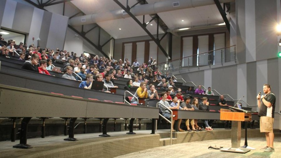 Students listen as tech companies pitch their organizations and available opportunities. (Photo by Fred Knapp, NET News)