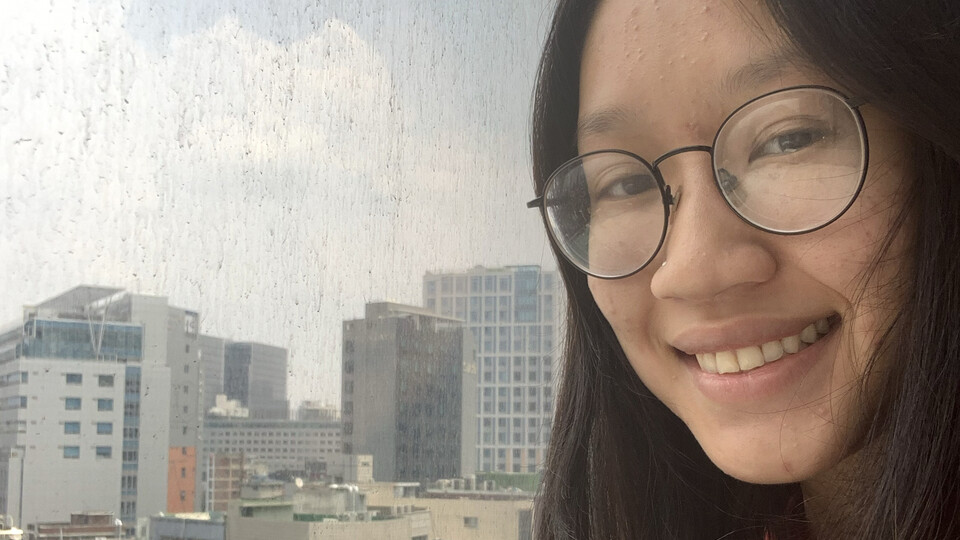 Jennifer Au looks out over Seoul, South Korea from her hotel room during a mandatory two-week quarantine.