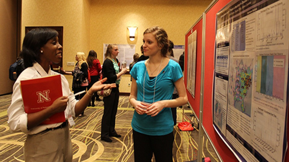 Students discuss their research during a poster session at the 2014 Nebraska Conference for Undergraduate Women in Mathematics.