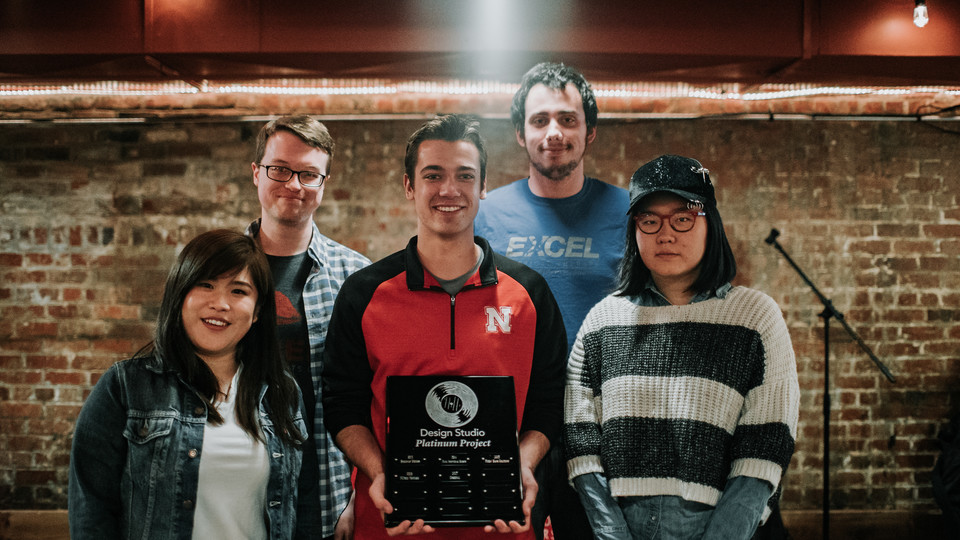 Design team Sensi-Plate accepting its platinum award earned during the 2018 Senior Design/Design Studio Showcase.
