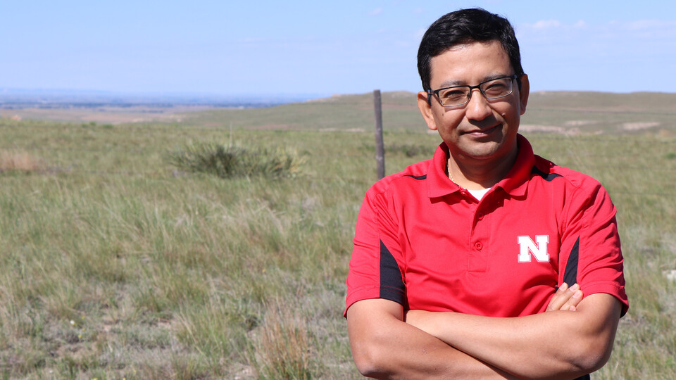 Bijesh Maharjan stands in front of a pasture north of Scottsbluff consisting of native soil and plant communities. His concept would define Soil Health Gap as the difference between soil health in an undisturbed native virgin soil and soil health in a giv