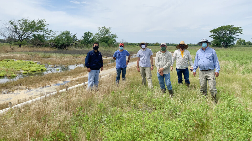 UNL researchers exploring suitable sites for deployment of the wireless-based sensor networks.