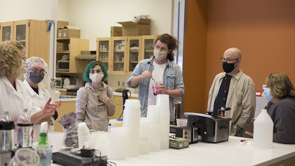 """""""Dracula: Mina's Quest."""" Right: (Left to right) Bethany Jackson, Zoe Kraus, Camille Lerner, Nathan Alexander, Jamie Bullins and Julie Reiling work on the perfect formula for the blood used in """"Dracula: Mina's Quest"""" at the Food Innovation Center. Photo by"""