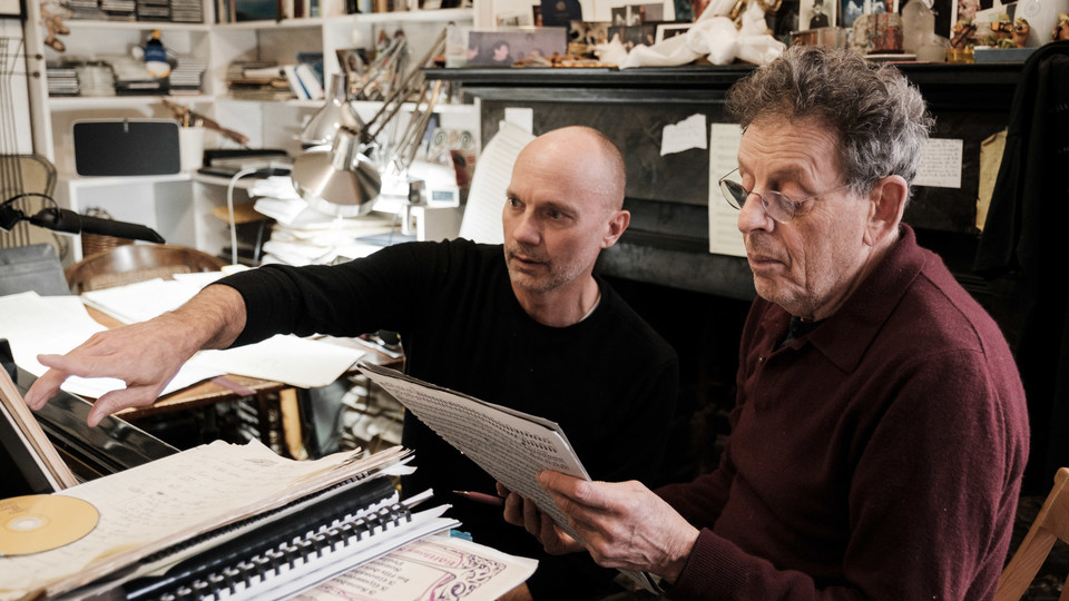 """Paul Barnes (left) and Philip Glass review the score for """"Annunciation."""""""