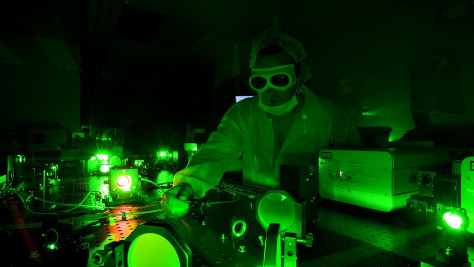 A technician adjusts the Diocles Laser in UNL's Extreme Light Laboratory. The lab is led by Donald Umstadter, one of four UNL researchers featured in the first report from the University of Nebraska's National Strategic Research Institute.