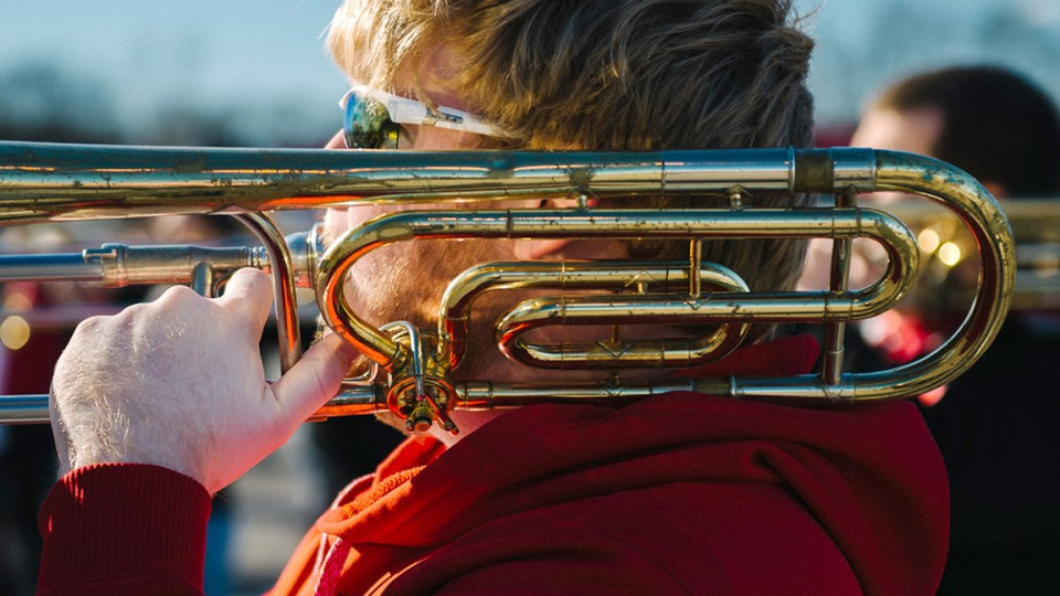 A trombone player practices during the Cornhusker Marching Band's trip to the Music City Bowl in December. Walker Pickering, a photography professor, has captured images of marching bands and drum corps since 2006.
