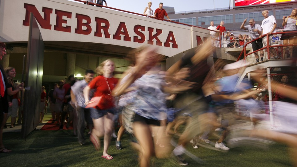 Students flood into Memorial Stadium during a UNL's annual Big Red Welcome event. This year, UNL will launch the First Husker program to offer support to first-generation college students.