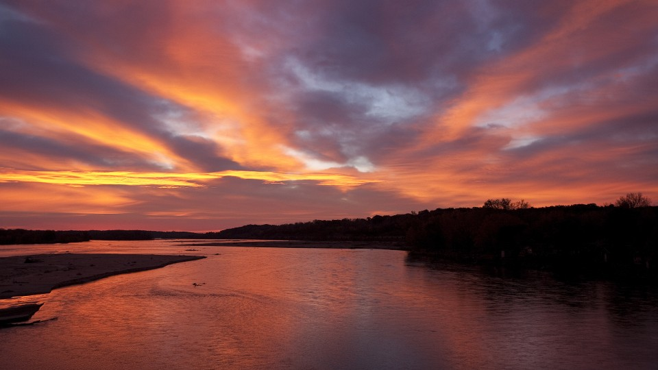 A sunset over the Platte River. A new report issued by the Conservation and Survey Division shows that nearly all of Nebraska saw declines in groundwater levels between spring 2012 and spring 2013.