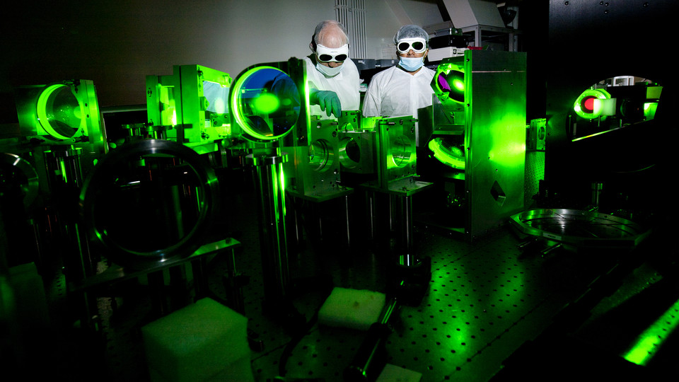 Researchers conduct tests with the Diocles Laser, which is part of the University of Nebraska–Lincoln's Extreme Light Laboratory. The laser is being used to further national defense research aimed at detecting bombs hidden in cargo containers.