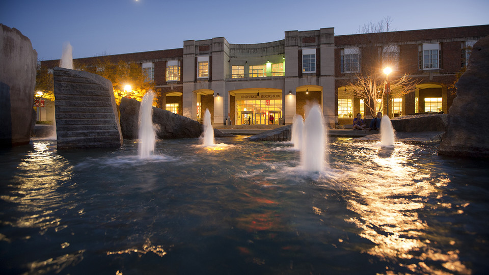 The modern design of UNL's Broyhill Fountain at night.