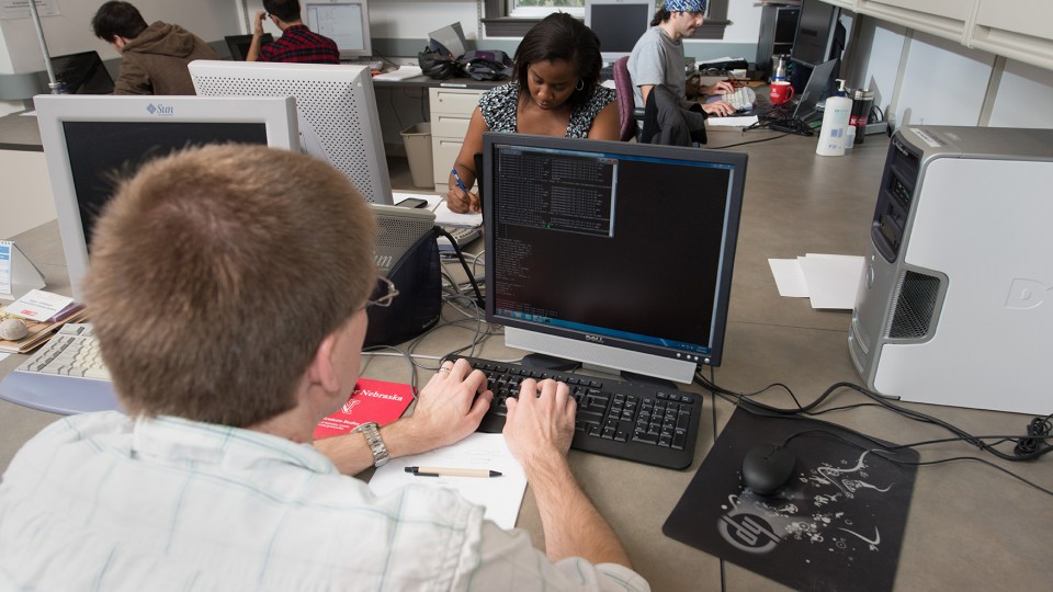 Students work on computers in UNL's Schorr Center. Information and Technology Services has launched a $1.5 million upgrade of the campus computing network. When complete, the project will double bandwidth available to campus buildings and high-demand locations.