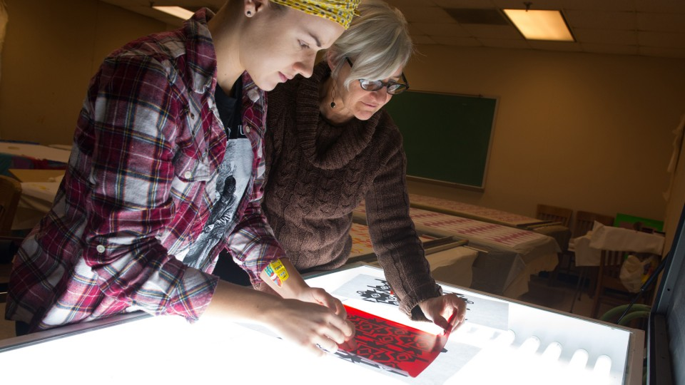 Wendy Weiss (right) works with a student in a Textiles, Merchandising and Fashion Design studio. Weiss received a second Fulbright that will allow her to expand research into the ikat weaving method.