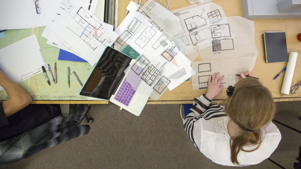 A student works on a design in an Architecture Hall classroom. Students in Architecture 310 designed concepts for Lincoln's Frank H. Woods Telephone Pioneer Museum, which is seeking a new home due to a real estate redevelopment project.