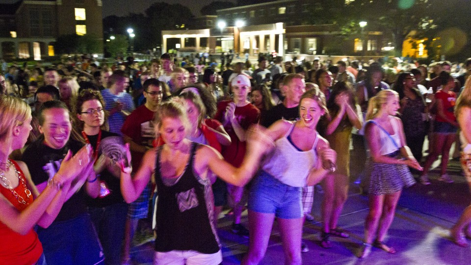 Students dance during a Big Red Welcome concert held on the greenspace north of the Nebraska Union on Aug. 23, 2013. The space will be used for a free April 9 concert featuring Big Sean and XV.