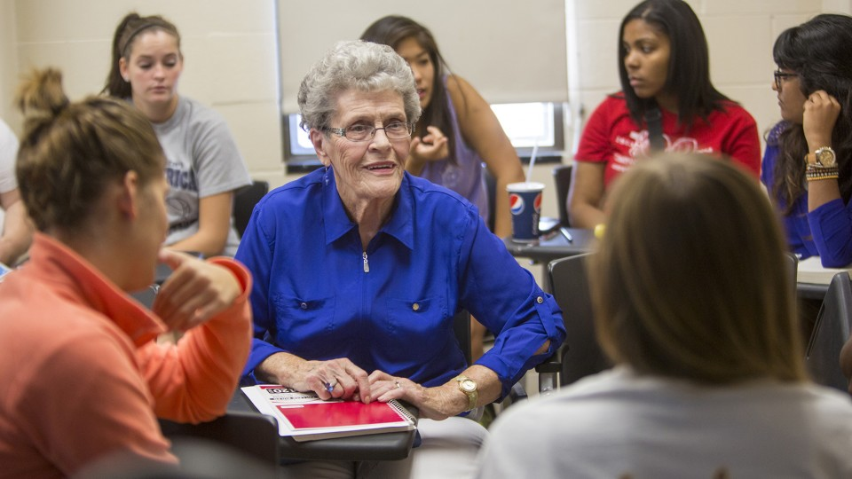 Jean Kops talks with students in a class during her junior year at UNL. Kops will graduate from UNL during commencement exercises on Aug. 15.