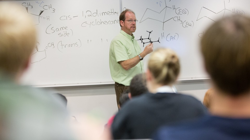 Patrick Dussault, professor of chemistry, leads an organic chemistry lecture. Dussault has earned a three-year National Science Foundation grant to examine new methods of synthesizing ethers.