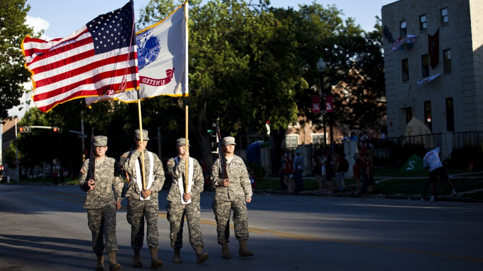 The opening of the 2013 UNL homecoming parade was led by the Army ROTC color guard.