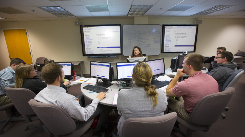 Donna Dudney, associate professor of finance in the College of Business, leads a finance course. The Board of Regents approved a name change for the college, dropping the name administration, on March 31.