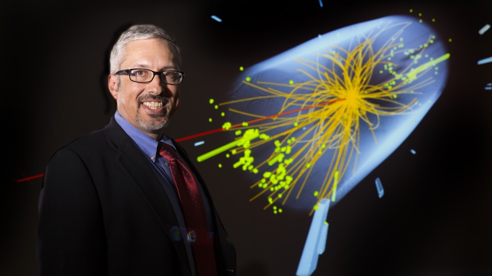 UNL physicist Aaron Dominguez leads collaboration involving eight universities to upgrade the Compact Muon Solenoid particle detector, a key component of the world's largest physics experiment. The illustration shows an event, captured by CMS in 2012, that provides evidence of the Higgs boson.