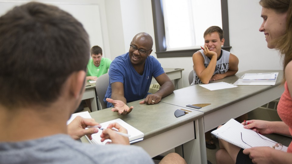 Deadric Williams (second from left), a post-doctoral research associate, leads a discussion with students in his sociology class. A recent poll of rural Nebraskans showed that 65 percent of respondents said a college degree is necessary to get ahead in life.