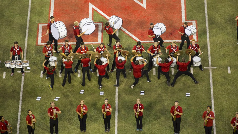 The 2014 Cornhusker Marching Band performs during UNL's Big Red Welcome festivities at Memorial Stadium on Aug. 22. The band will reveal an updated pregame and the first of eight new halftime shows during the Aug. 30 Husker football game against Florida Atlantic.