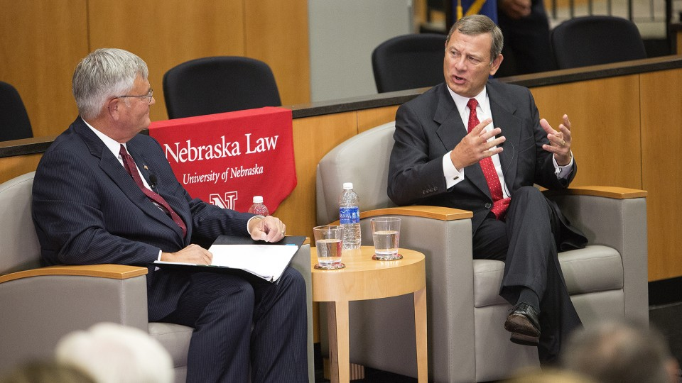 U.S. Chief Justice John Roberts (right) answers a question from William Jay Riley, Chief Judge of the Eighth U.S. Circuit Court of Appeals, during the Sept. 19 discussion at the University of Nebraska's College of Law.