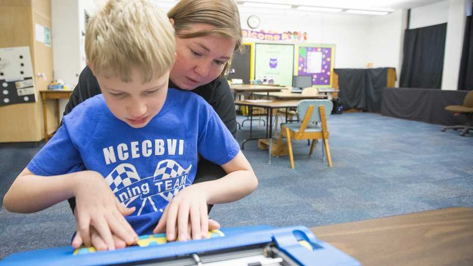 A teacher works with a student in the Nebraska Center for the Education of the Blind in Nebraska City. A UNL researcher has earned a $1.1 million grant that will be used to teach 30 graduate students to teach children and youth with sensory disabilities.