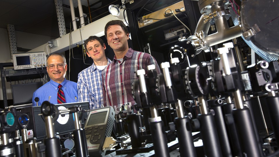 UNL physicists, from left, Anthony Starace, Martin Centurion and Herman Batelaan lead UNL's work with the Nebraska-Kansas Consortium.