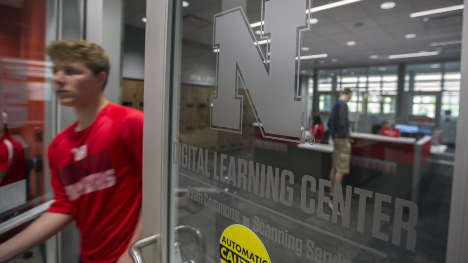 A student passes through the door to the Digital Learning Center after completing a final exam on May 4.