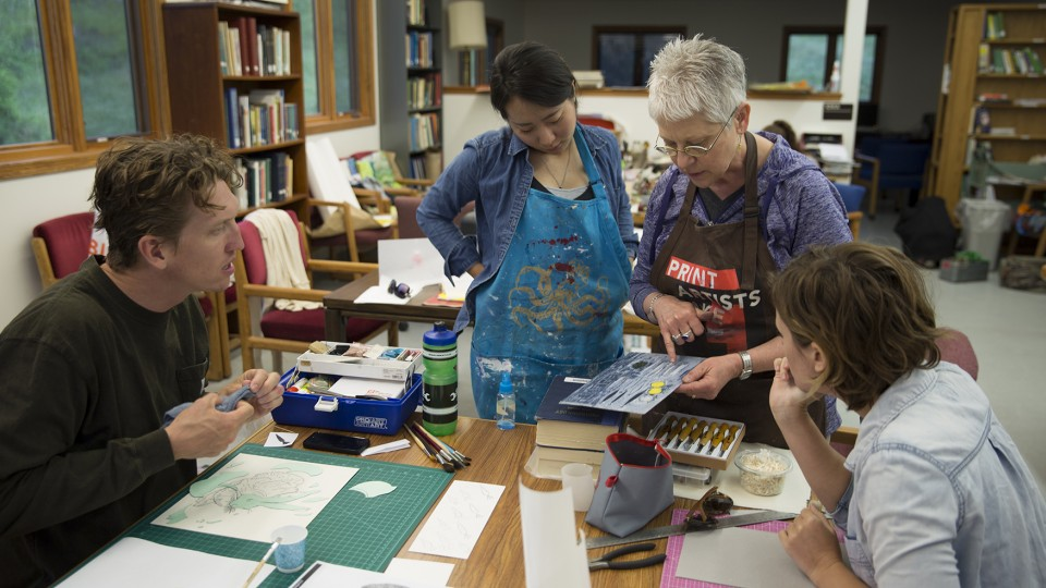 Karen Kunc, professor of art, discusses a printmaking techique with students enrolled in the Art at Cedar Point course. The new summer course is held at the UNL's Cedar Point Biological Station and allows students to focus solely on creating art for two weeks.